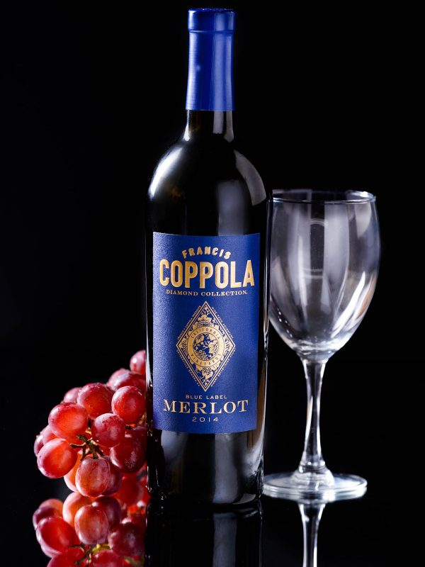 Francis Coppola Merlot Wine Bottle Grapes Product Photography